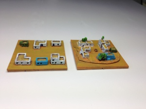 Some 2mm villages - Brigade Models on the left and Irregular Miniatures on the right