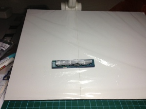 This metallic sheet on an MDF board about A4 size covered in Glad Wrap (Saran Wrap)