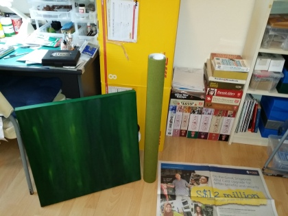 The raw materials - the painted canvas and a roll of Woodland Scenics grass mat