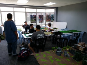 The guys getting ready for start of DeBAKLe 2013  -- organiser David Khoo is sitting, back to the camera preparing the first round draw