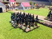 The Caçadores form square in front of the advancing French cavalry