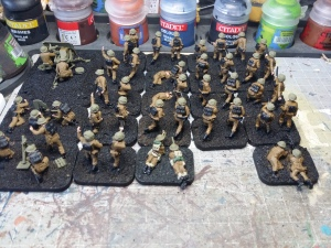 Uniforms painted - now starting to look like soldiers. Note how the two figures already painted are starting to merge in with the others