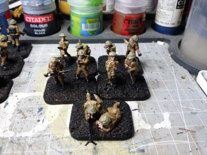Webbing and packs were painted in a khaki colour