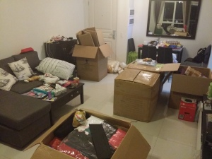 The boxes in the lounge room. Three boxes unpacked and four to go!