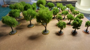 The finished product - trees on coins, nicely weighted and ready for some ground texture and paint.