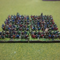 The members of the shield wall - spearmen fighting closely packed